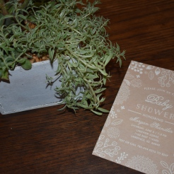 Succulent centerpieces and invitations from Minted