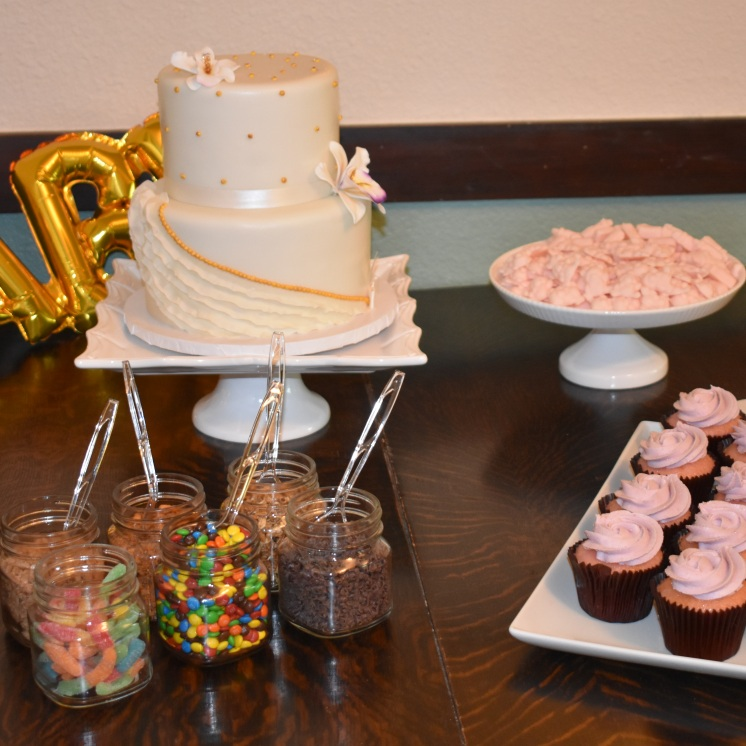 Beautiful dessert table with cake, homemade mints and toppings for homemade ice cream